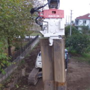 Excavator Mounted Vibratory Hammer is Driving Double Palplanj