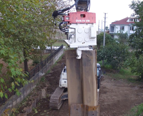 Excavator Mounted Vibratory Hammer is Driving Double Palplanj